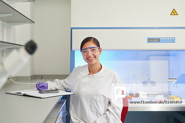 Portrait of scientist in laboratory looking at camera smiling