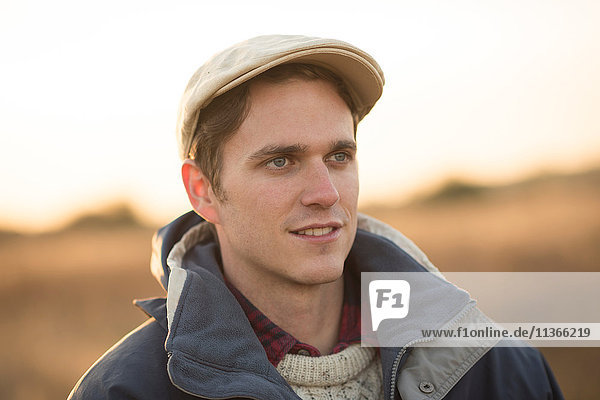 Portrait of young man in rural setting