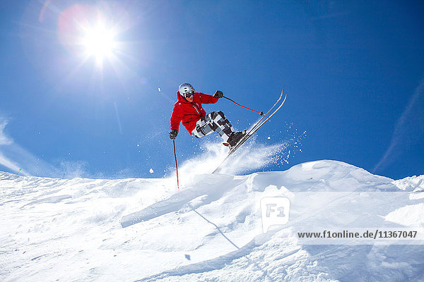 Skier  skiing downhill  low angle view