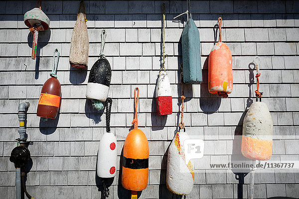 Variety of traditional fishing buoys hanging on wall  Lunenburg  Nova Scotia  Canada