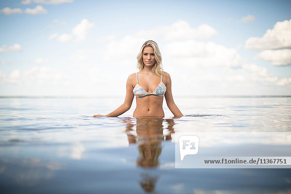Portrait of beautiful woman with long blond hair in sea  Santa Rosa Beach  Florida  USA
