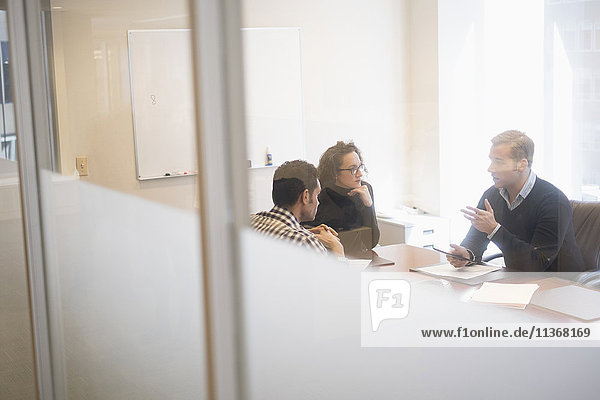 Young business people having meeting in board room