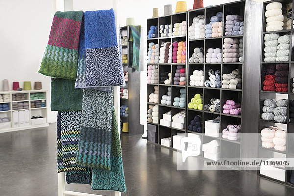 Handcrafted woolen scarves for sale at clothes shop