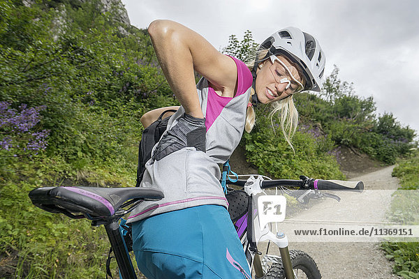 Mountainbiker with pain in back  Kampenwand