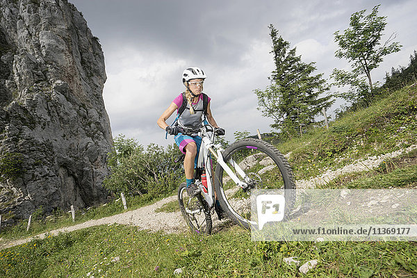 Mountain biker riding on uphill  Kampenwand