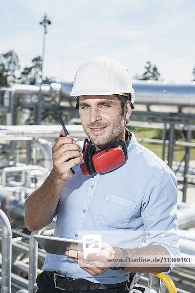 Male engineer talking with walkie-talkie at geothermal power station Male engineer talking with walkie-talkie at geothermal power station