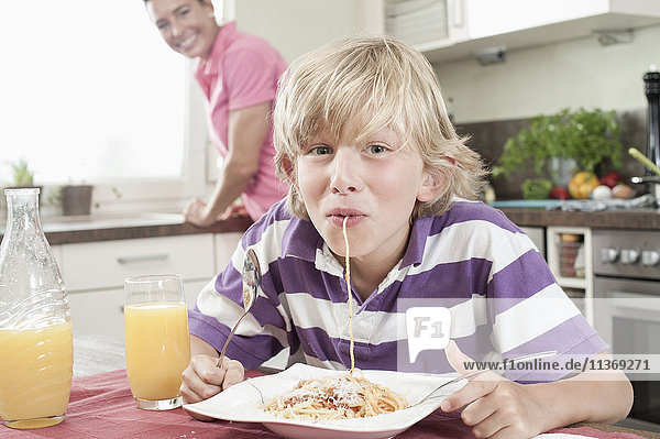 Portrait of a boy eating spaghetti