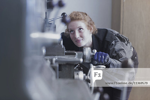 Young female engineer working in an industrial plant