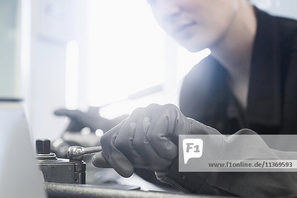 Female engineer in workshop with a lever in hand