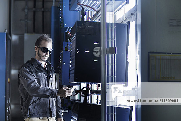 Young male engineer working in technology space