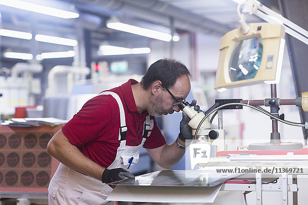 Male engineer examining circuit board in industry  Hanover  Lower Saxony  Germany