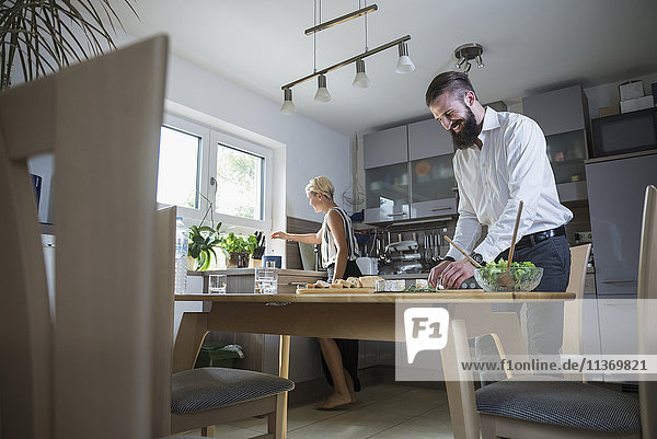 Young couple preparing food in the kitchen