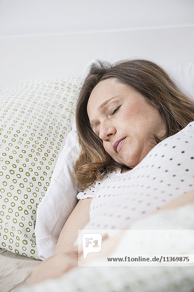 Pregnant woman sleeping in bed Pregnant woman sleeping in bed