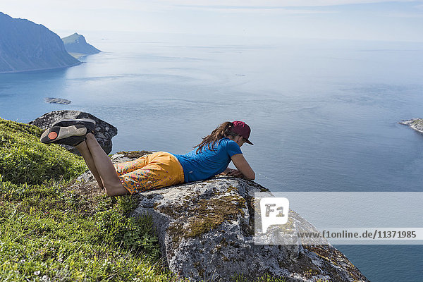 Woman looking at sea from cliff