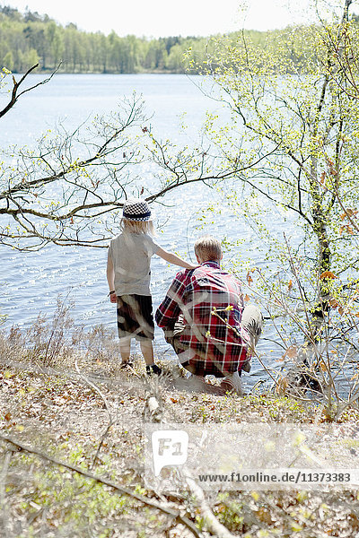 Father with son by lake