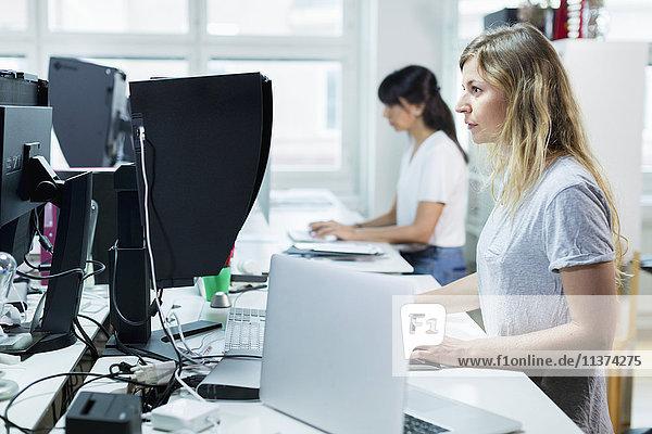 Women in office using computer