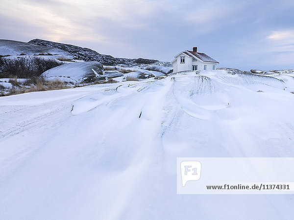 House on rocks at winter