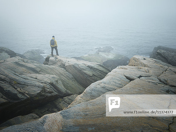 Hiker on rocky coast