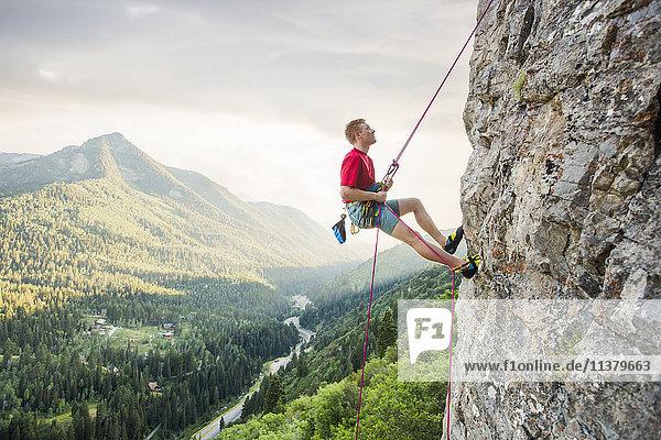 Caucasian man rock climbing