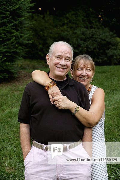 Portrait of smiling Caucasian couple outdoors