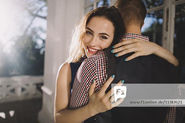 Smiling Caucasian couple hugging