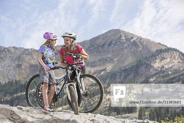 Caucasian grandmother and granddaughter with mountain bikes