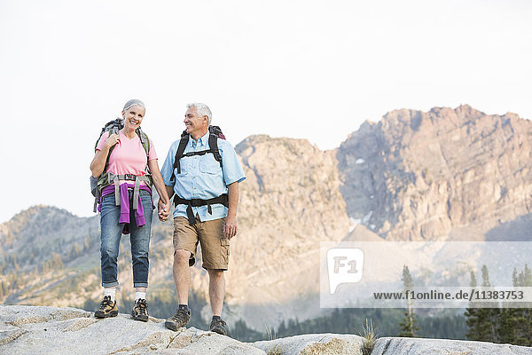 Caucasian couple hiking on mountain