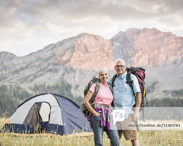 Caucasian couple camping on mountain