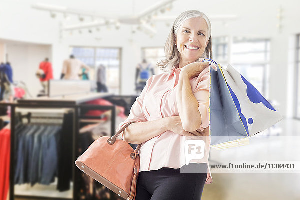 Portrait of Caucasian woman holding shopping bags