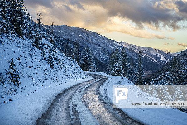 Snow on winding mountain road