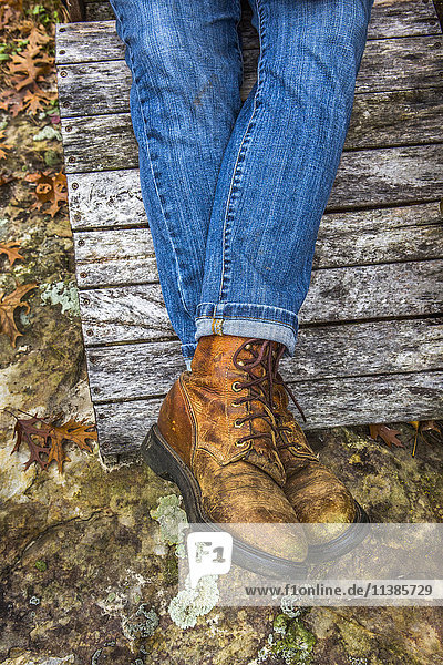 Legs of Caucasian woman wearing jeans and boots