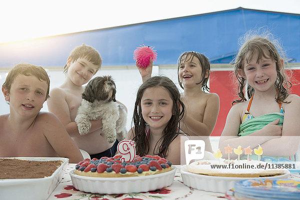 Smiling Caucasian children posing at birthday party
