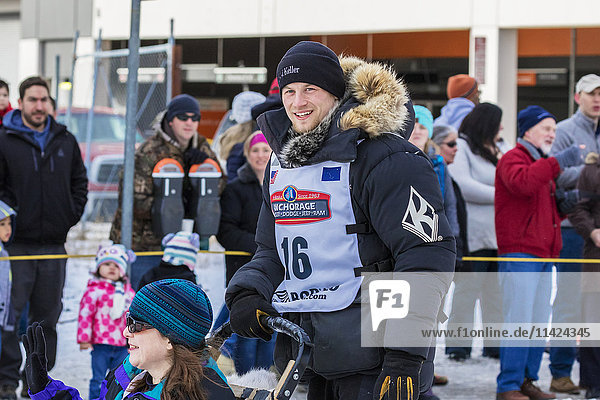 View of Dallas Seavey at the cermonial start of the 2016 Iditarod Dog Sled Race in downtown Anchorage  Alaska  USA  Winter.