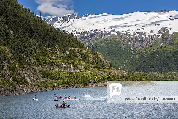 A family enjoying water sports on Portage Lake in Portage Valley  Summer  Alaska  USA.