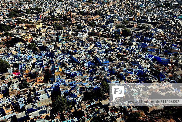 The city is dubbed the Blue City for the painted houses in its ancient heart  seen from the ramparts of the fort that towers 120 m above the city. It is Rajasthan's second-largest city  with a population of about 1.24 million. Jodhpur  Rajasthan  India. (Photo by: Auscape/UIG)