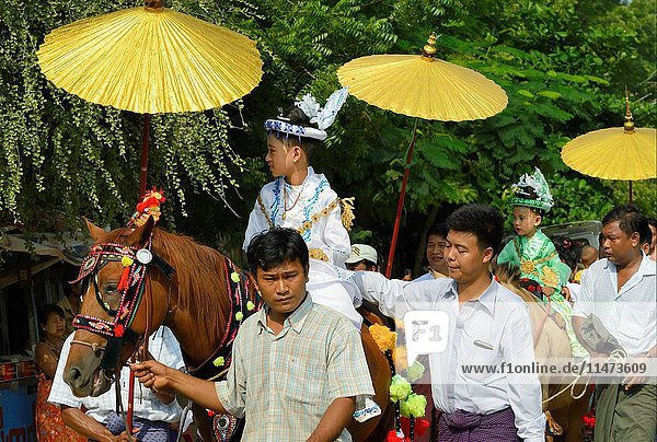 Myanmar  Bagan  Shinbyu  Novitiation ceremony. Young children are dressed as royal princes in memory of prince Siddharta Gautama's departure from his royal home in search of enlightment.