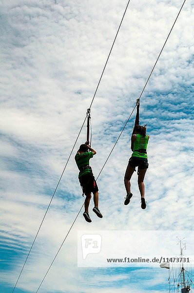 A man and a woman on a zip line  Halifax  Canada