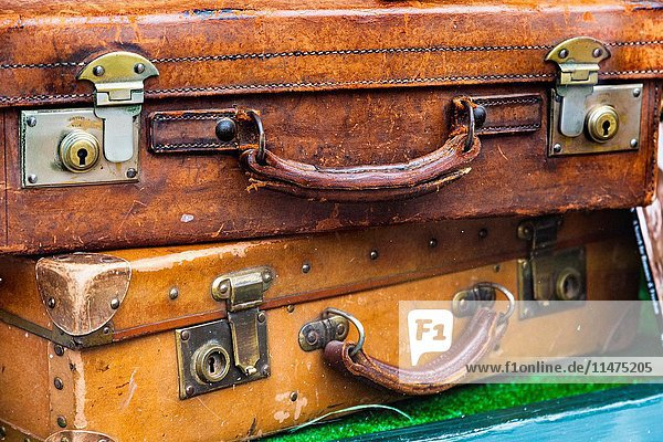 Two antique suitcases in a shop window  Keswick  Cumbria  England.
