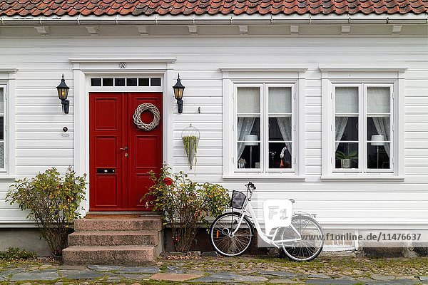 Traditional colorful wooden house in Kristiansand  Norway.