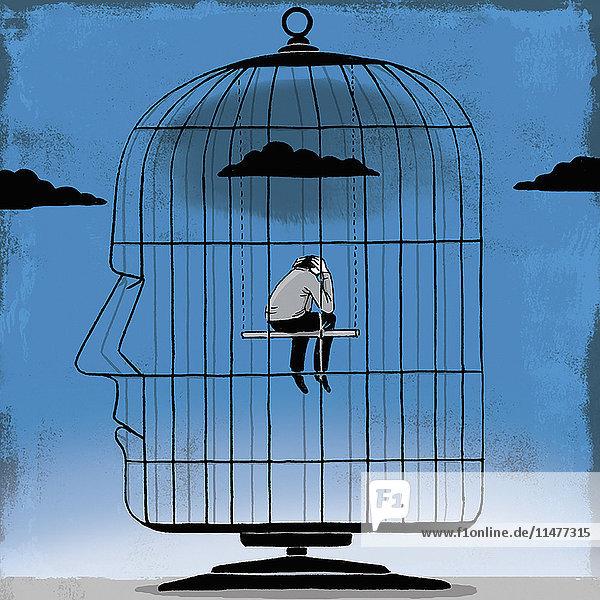 Deprimierter Mann in einem Vogelkäfig in Kopfform