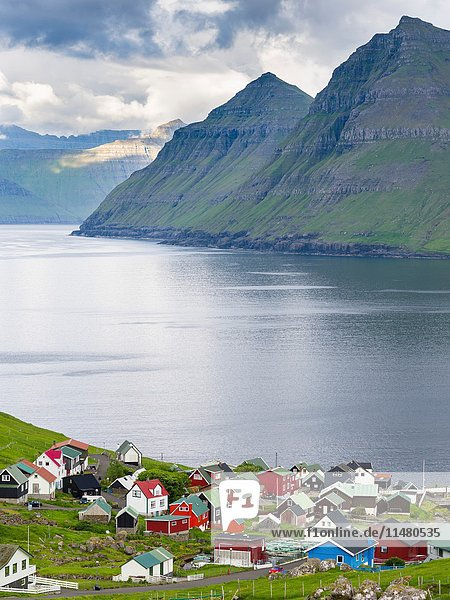 Village Funningur   in the background Funningsfjordur  Leiriksfjordur and the island Kalsoy. The island Eysturoy one of the two large islands of the Faroe Islands in the North Atlantic. Europe  Northern Europe  Denmark  Faroe Islands.