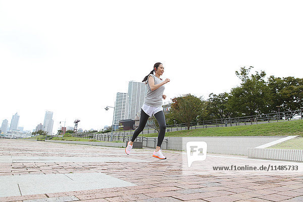 Attractive Japanese woman training by a river downtown Tokyo  Japan