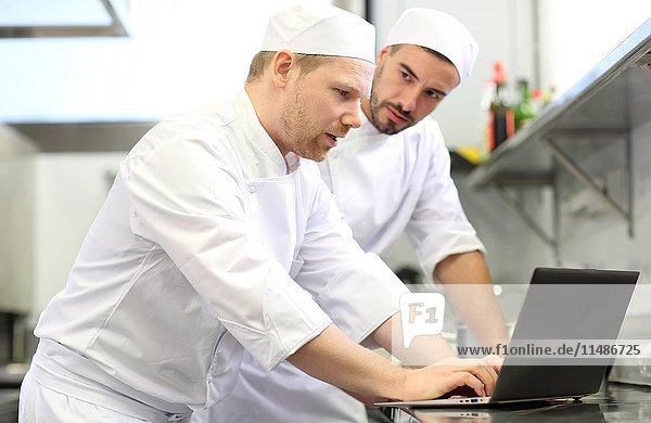Chef with laptop computer  Cook in cooking school  Cuisine School  Donostia  San Sebastian  Gipuzkoa  Basque Country  Spain  Europe