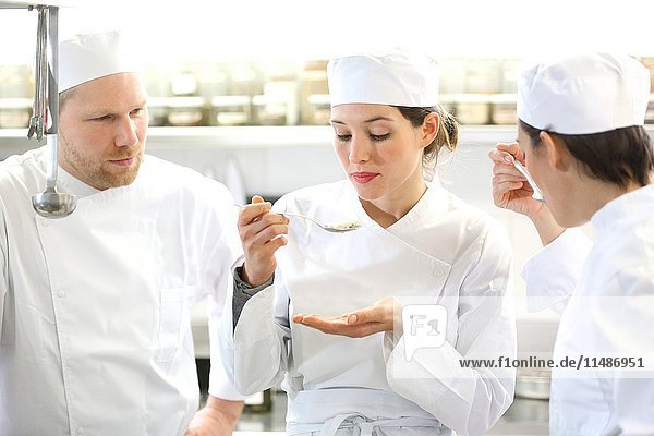 Chef trying food  Cook in cooking school  Cuisine School  Donostia  San Sebastian  Gipuzkoa  Basque Country  Spain  Europe