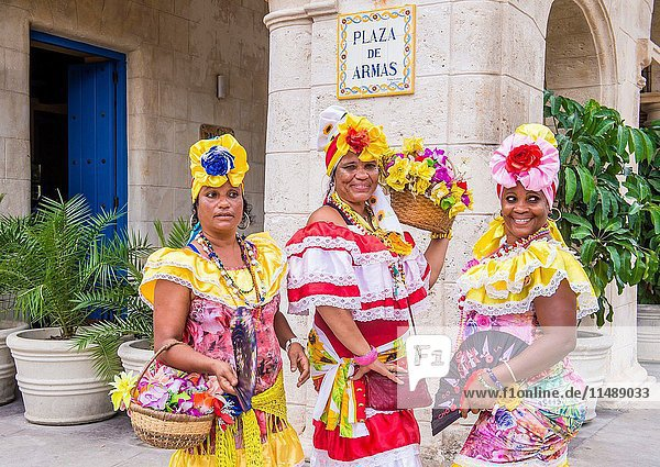 Cuban women with traditional clothing in old Havana street. The historic center of Havana is UNESCO World Heritage Site since 1982.