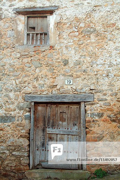 Old door housing in Villoslada de Cameros natural park of the Sierra Cebollera. La Rioja.