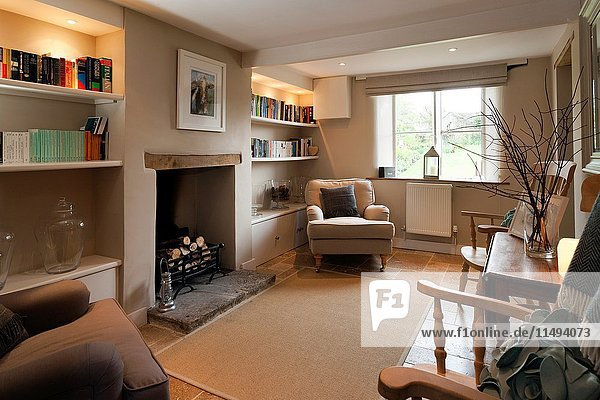 UK homes. Contemporary furniture in a simple cottage sitting room. For Editorial Use Only.