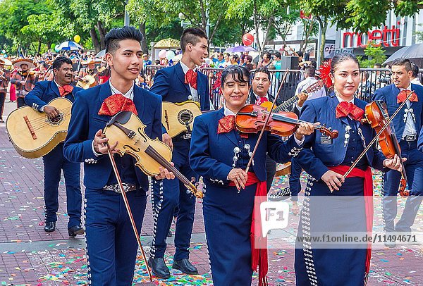 Participants in a parde during the 23rd International Mariachi & Charros festival in Guadalajara Mexico.