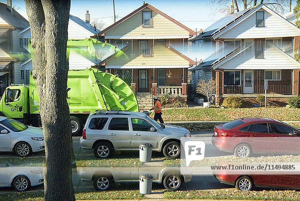 Garbage pick up day as seen through a front door window giving a split image  Windsor  Ontario.