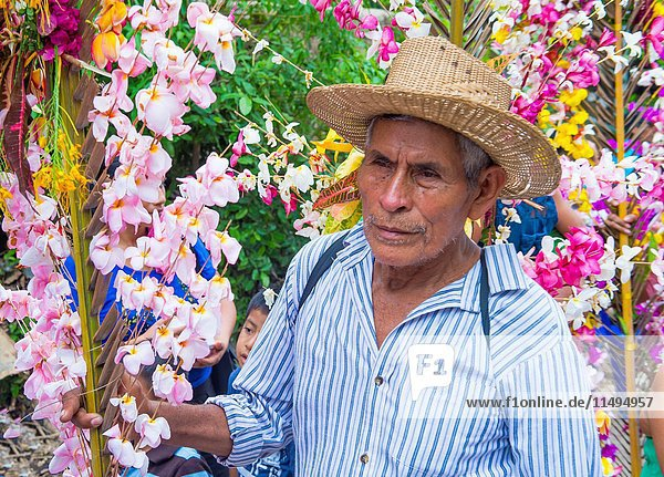 Salvadorian people participate in the procession of the Flower & Palm Festival in Panchimalco  El Salvador.